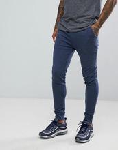 ASOS | Супероблегающие джоггеры джинсового цвета ASOS - Синий | Clouty
