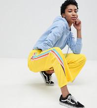 ASOS   Спортивные штаны с полосками по бокам и разрезами ASOS DESIGN Tall   Clouty