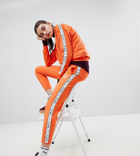 Puma   Оранжевые спортивные штаны Puma эксклюзивно для ASOS - Оранжевый   Clouty