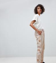 Ivy Park   Спортивные брюки с полосками по бокам Ivy Park - Бежевый   Clouty