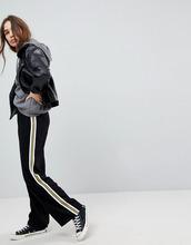 ASOS   Спортивные штаны с широкими штанинами и отделкой кантом ASOS Tailored   Clouty