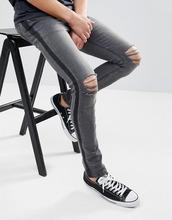 ASOS   Черные выбеленные джинсы скинни с полосками по бокам и рваной отделкой   Clouty