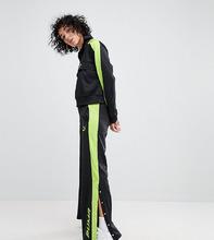 Puma   Черные спортивные штаны с зеленой отделкой Puma эксклюзивно для ASOS   Clouty